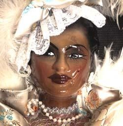 12in x 8in Fancy Porcelain Black Doll Face w/ White Feather