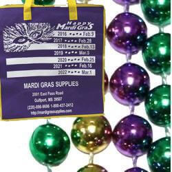 Metallic purple, green, and gold Mardi Gras throw beads