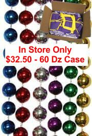 Assorted color Mardi Gras beads: red, silver, blue, purple, green, and gold.