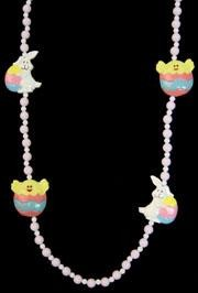 "Specialty Easter items include a set of 42"" Easter Beads, a religious rubber duck necklace, butter fly beads, and assorted color beads."