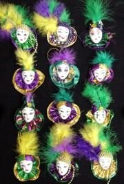 Mardi Gras pins, brooches, and magnets featuring painted ceramic doll faces and Venetian masks are great costume accessories, souvenirs, and memorabilia.