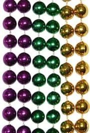 Mardi Gras beads in traditional purple, green, and gold colors