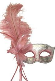 Venetian style masquerade masks often come with a decorative stick attached to the side of the mask and the mask on a stick is held up with the right hand.